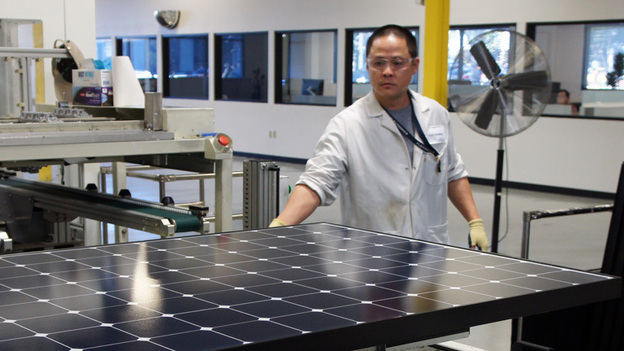 Solar panels come off the line at SunPower's solar manufacturing plant near San Jose, Calif. (Lauren Sommer for NPR)