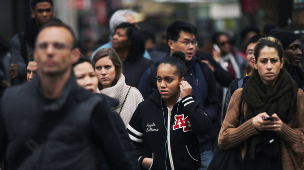 A crowd crosses the street in midtown Manhattan. (Getty Images)
