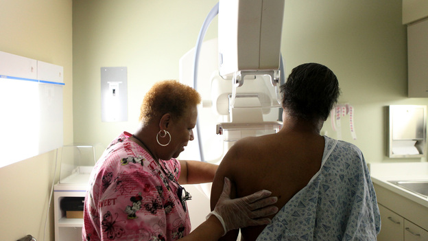 Betty Daniel gets a routine yearly mammogram from mammography tech Stella Palmer at Mount Sinai Hospital in Chicago in 2012. (MCT/Landov)