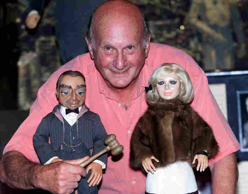 Thunderbirds creator Gerry Anderson has died at age 83. Here, he poses with puppets Parker and Lady Penelope from the series, shortly before a 2001 auction in London.