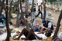 A member of Rio de Janeiro's Social Work Department speaks with crack addicts in  a slum area known as