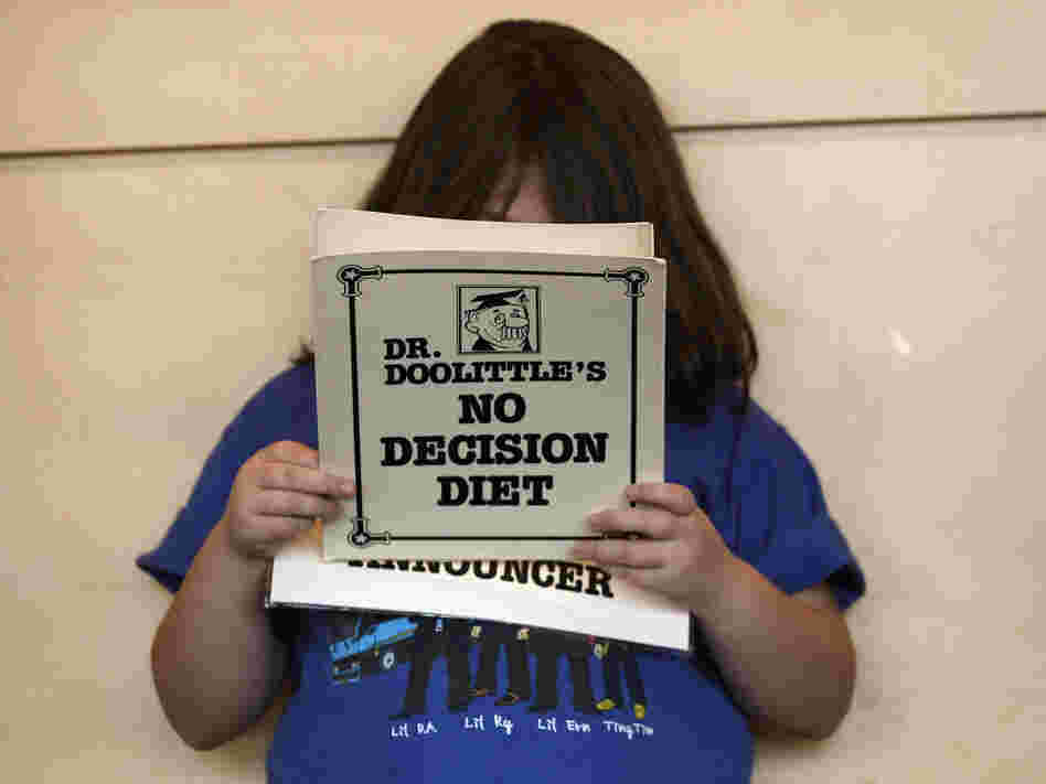 An overweight child reads her part during a skit that was in a 2010 program promoting healthy lifestyles sponsored by Children's Hospital near Denver.