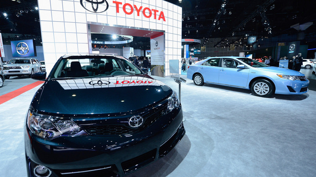 """Toyota has agreed to spend more than $1 billion to resolve lawsuits stemming from """"unintended acceleration"""" cases. In November, the company displayed new cars at the Los Angeles Auto show. (Getty Images)"""