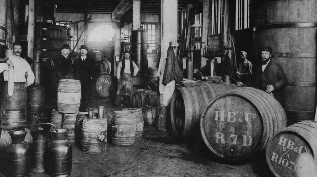 Workers pose for a photo at the Hoboken de Bie & Co. gin distillery in Rotterdam, Netherlands, circa 1900. By the end of the 19th century, cocktail culture had helped make gin a more respectable spirit. (Getty Images)
