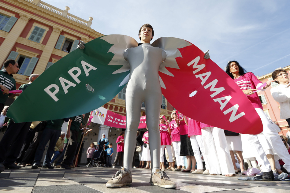 "A man wears a costume reading ""Dad"" and ""Mom"" during a demonstration against gay marriage and adoption by same-sex couples in Nice, France, in October."