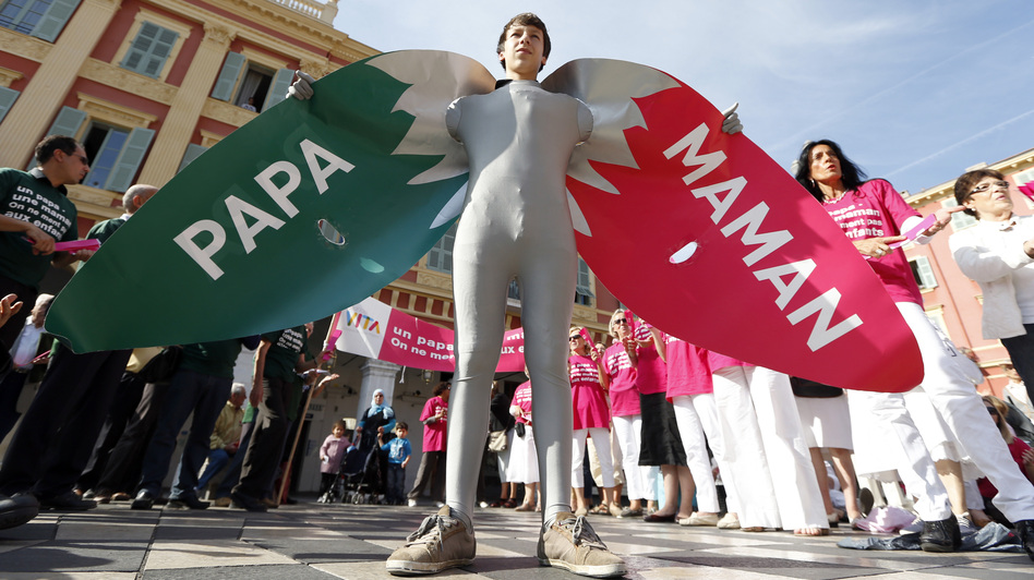 "A man wears a costume reading ""Dad"" and ""Mom"" during a demonstration against gay marriage and adoption by same-sex couples in Nice, France, in October. (AFP/Getty Images)"