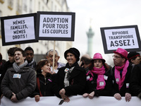 People hold placards reading and support of legalizing marriage and adoption for gay couples, during a demonstration in Paris on Dec. 16.