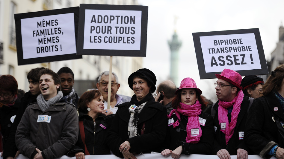 People hold placards reading and support of legalizing marriage and adoption for gay couples, during a demonstration in Paris on Dec. 16. (AFP/Getty Images)