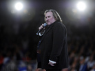 French actor Gerard Depardieu speaks outside Paris in March. He recently said he was moving to neighboring Belgium to avoid France's new top tax rate of 75 percent. The news ignited a debate in France over taxes and patriotism.