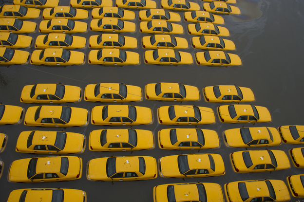 A parking lot full of yellow taxis is flooded as a result of Hurricane Sandy on Oct. 30 in Hoboken, N.J. (AP)