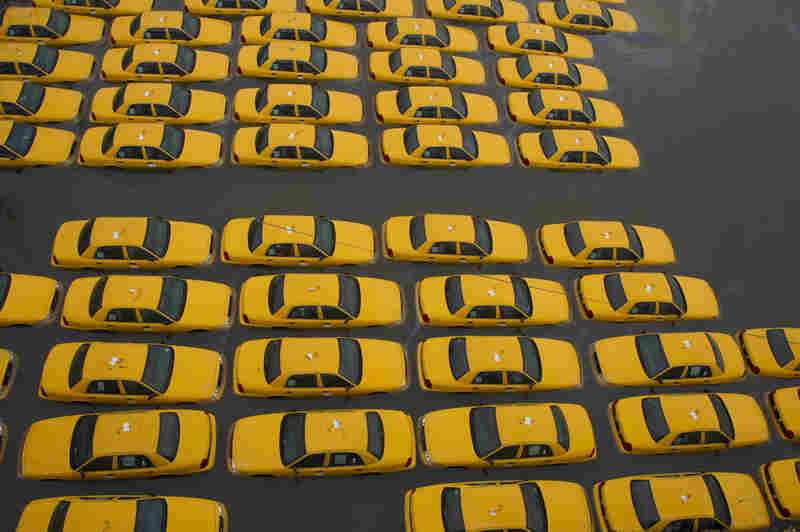 A parking lot full of yellow taxis is flooded as a result of Hurricane Sandy on Oct. 30 in Hoboken, N.J.