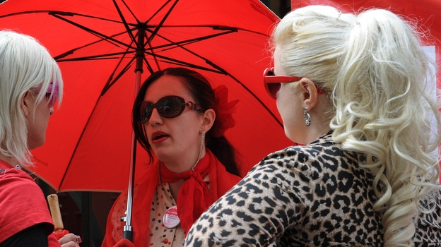 Supporters of the Scarlet Alliance Australian Sex Workers Association demand better legal protections at a rally outside the New South Wales Parliament in September. (AFP/Getty Images)
