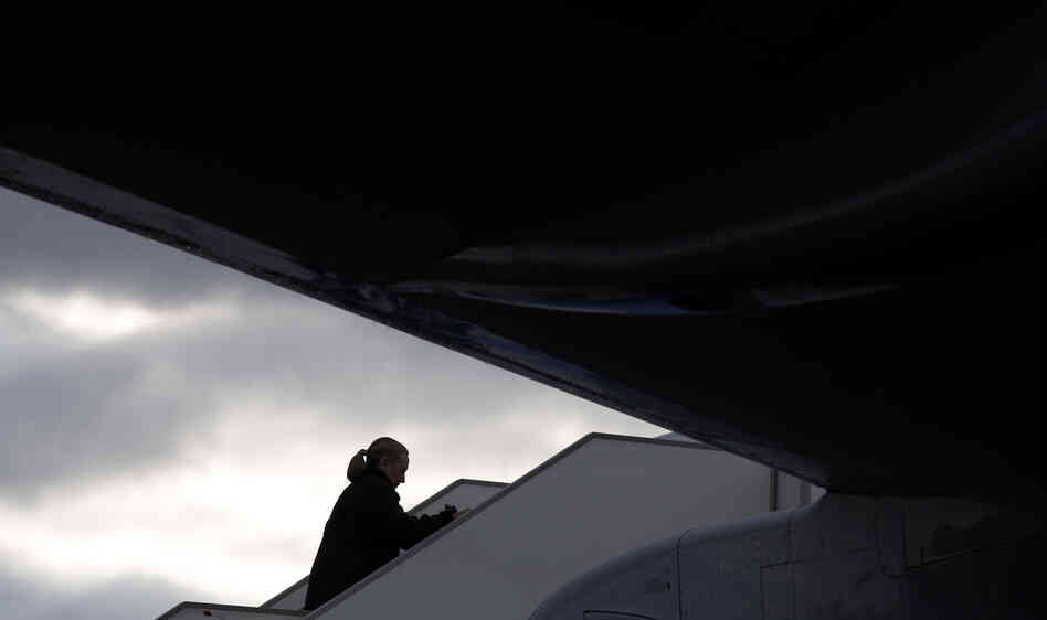 Hillary Clinton, shown here boarding