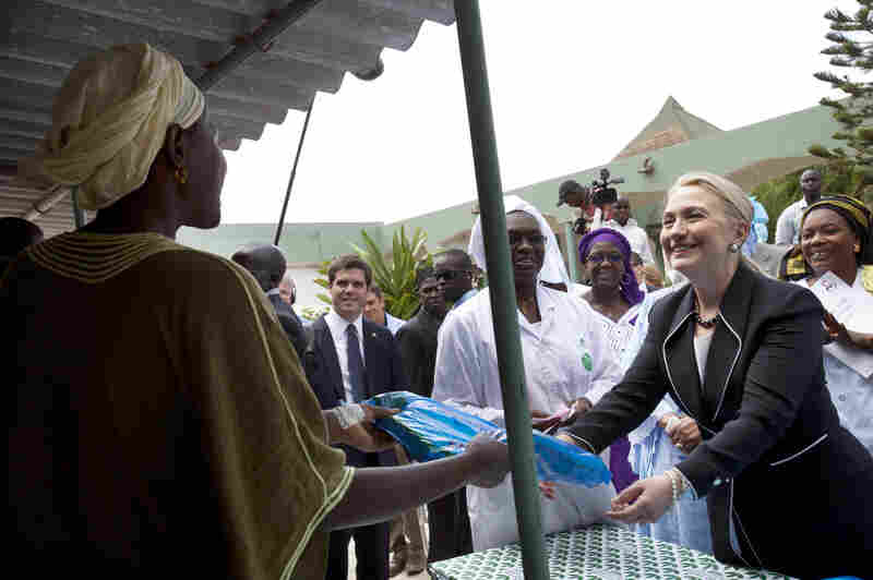 Clinton often focused on humanitarian issues. Here, she gives a mosquito net for malaria prevention to a woman during a tour of a health center in Dakar, Senegal, in August.