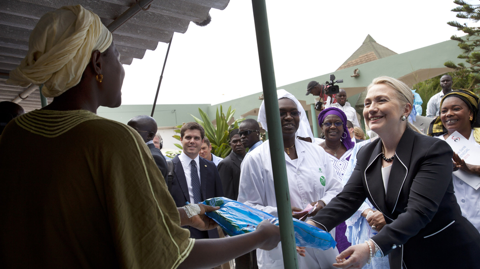 Clinton often focused on humanitarian issues. Here, she gives a mosquito net for malaria prevention to a woman during a tour of a health center in Dakar, Senegal, in August. (AP)