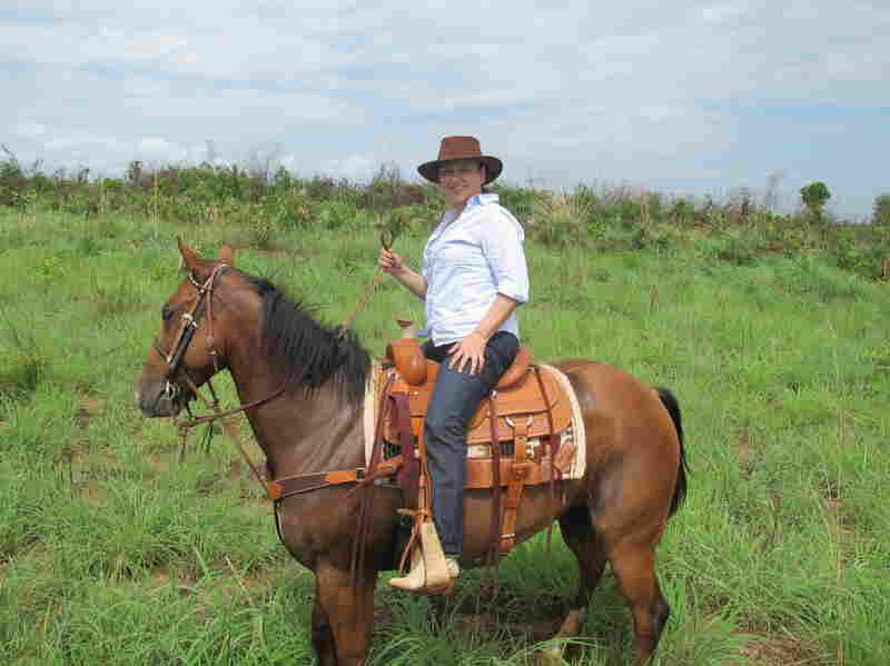 Abreu surveys the farm she owns in Tocantins state in north-central Brazil, on horseback.