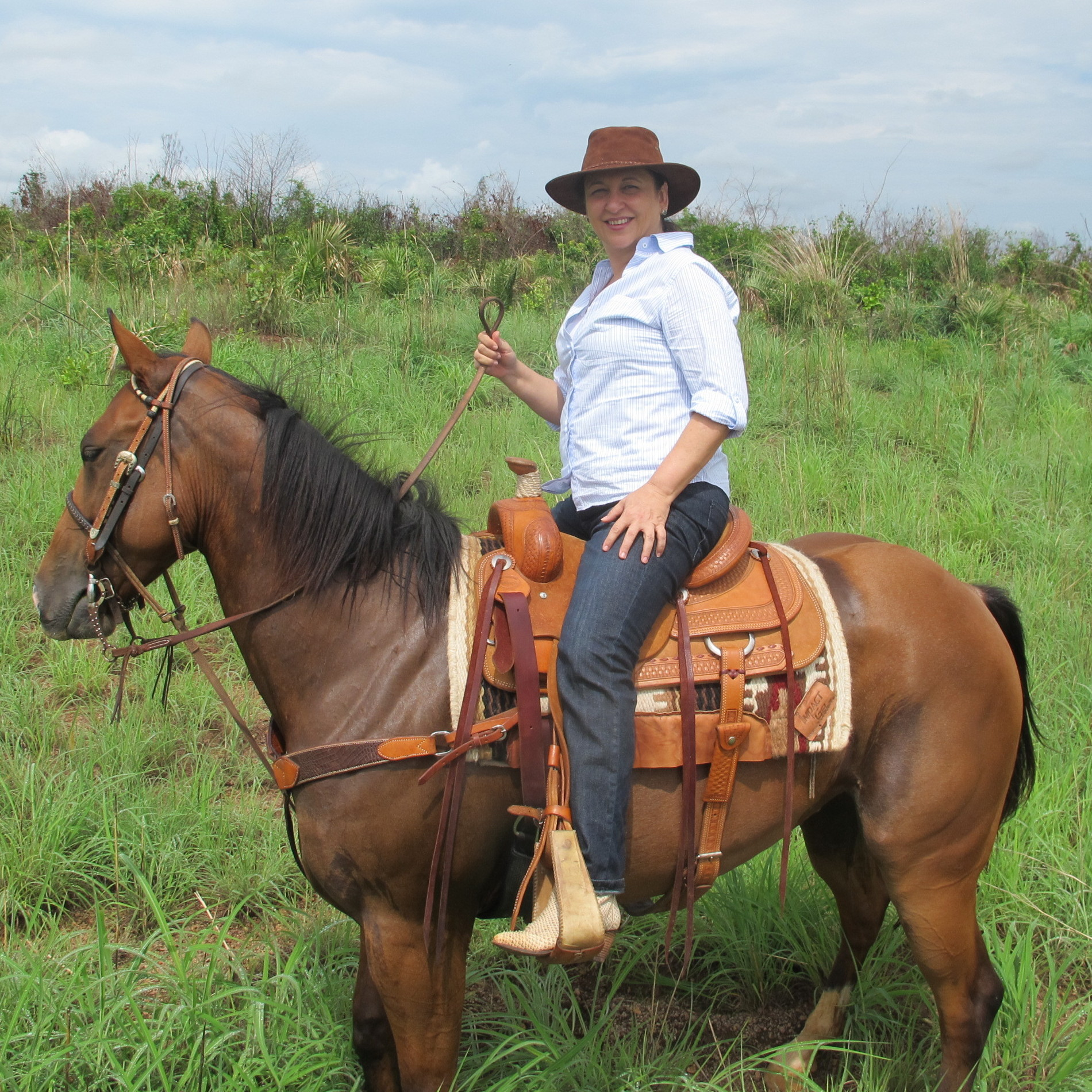 Abreu surveys the farm she owns in Tocantins state in north-central Brazil, on horseback.