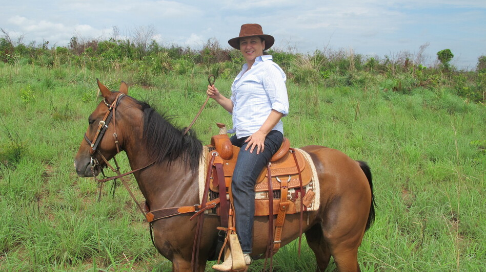 Abreu surveys the farm she owns in Tocantins state in north-central Brazil, on horseback. (Juan Forero)