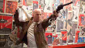 Joe (Bruce Willis) fights a younger version of himself in Looper.
