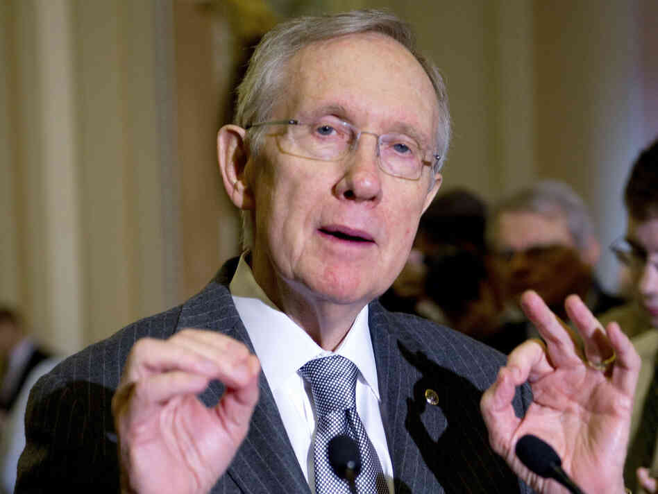 Senate Majority Leader Harry Reid, D-Nev., addresses reporters about ongoing discussion