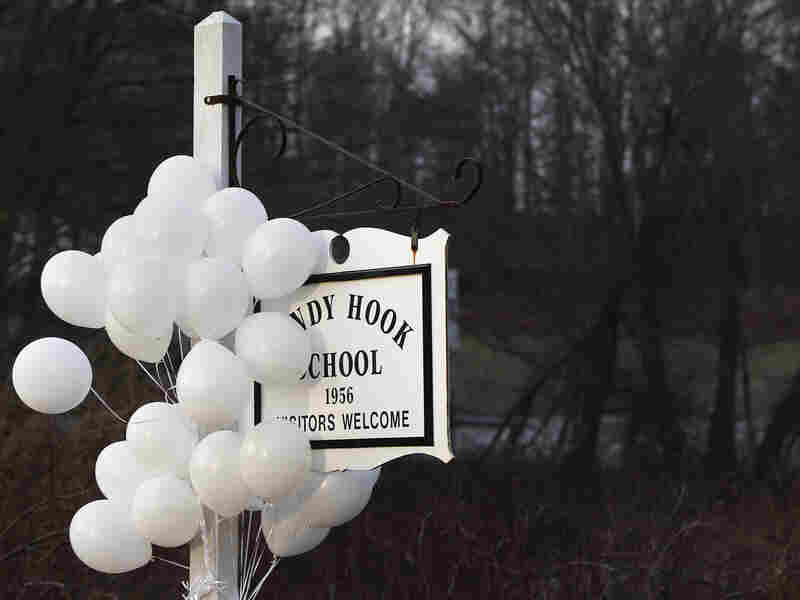 After the attack: Balloons hung from the Sandy Hook Elementary School sign on Dec. 15. On Dec. 14, six adults and 20 children were killed there before the gunman took his own life.