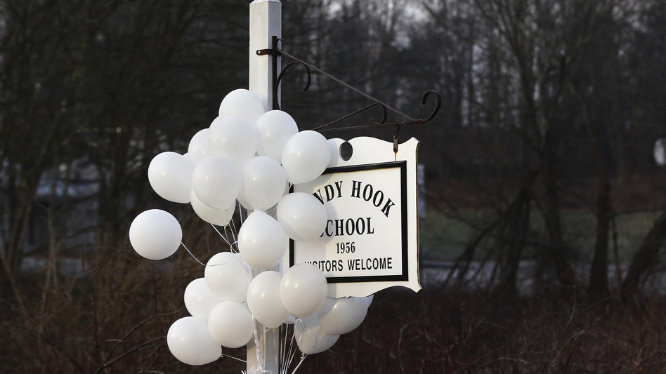 After the attack: Balloons hung from the Sandy Hook Elementary School sign on Dec. 15. On Dec. 14, six adults and 20 children were killed there before the gunman took his own life. (Reuters /Landov)