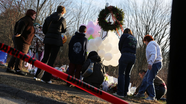 People visit a memorial outside Sandy Hook Elementary School in Newtown, Conn., on Dec. 15. (Getty Images)