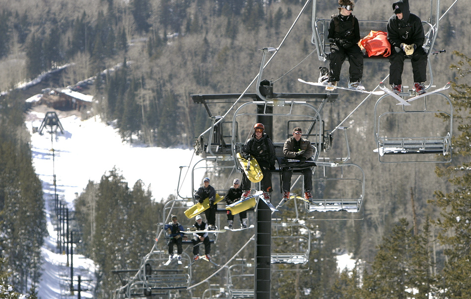 The Arizona Snowbowl resort began making snow exclusively with reclaimed wastewater this week. In this file photo, employees go up a ski lift at the resort.