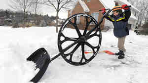 """Nathan Lee, 5, was using a """"wovel"""" to move snow from his family's driveway earlier today in State College Pa."""