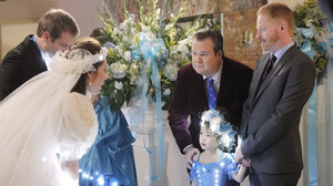 Mitchell (Jesse Tyler Ferguson) and Cam (Eric Stonestreet) adopt Lily (Aubrey Anderson-Emmons) from Vietnam in Modern Family.
