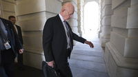 National Intelligence Director James Clapper leaves the Capitol after briefing members of Congress earlier this month. The Senate voted Friday to extend the FISA Amendments Act to 2017, granting federal agencies wide surveillance powers.