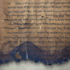 A fragment of the 2,000-year-old Dead Sea Scrolls is laid out at a laboratory in Jerusalem. More than 60 years after their discovery, 5,000 images of the ancient scrolls are now online.