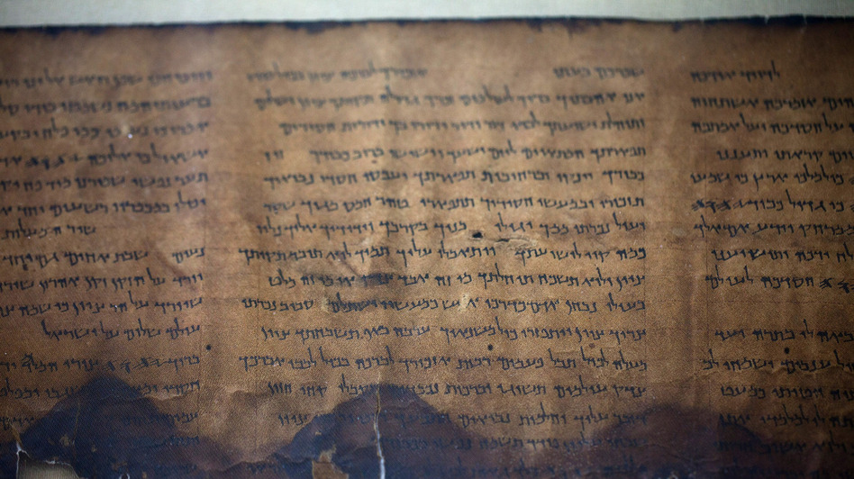 A fragment of the 2,000-year-old Dead Sea Scrolls is laid out at a laboratory in Jerusalem. More than 60 years after their discovery, 5,000 images of the ancient scrolls are now online. (Getty Images)