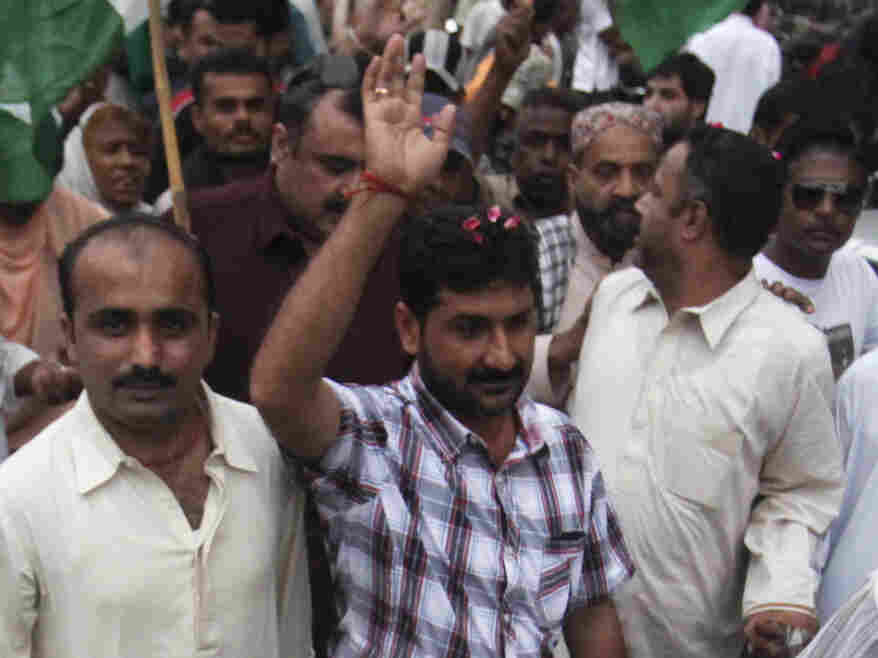 Uzair Baloch (center), 32, controls an impoverished section of Karachi and commands a large armed force. He is routinely described as a gangster, though he calls himself a politician and a social worker. He's shown here at a rally in Karachi in November 2011.