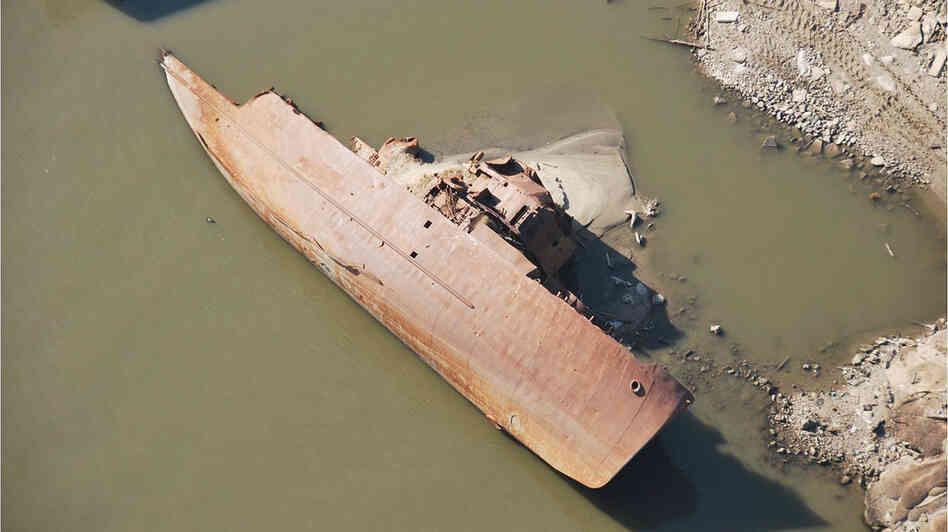 This WWII-era minesweeper once was a floating museum in St. Louis. Swept away in a 1993 flood, it has been under water in the river for most of the years since. But the ship has been exposed as the river's water level has fallen.