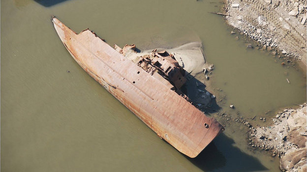 This WWII-era minesweeper once was a floating museum in St. Louis. Swept away in a 1993 flood, it has been under water in the river for most of the years since. But the ship has been exposed as the river's water level has fallen. (Photo taken on Dec. 14.) (Army Corps of Engineers)