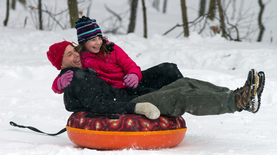 Eric Waite and his 8-year-old daughter Emerson went sliding Thursday in Greenfield, Mass. (Getty Images)