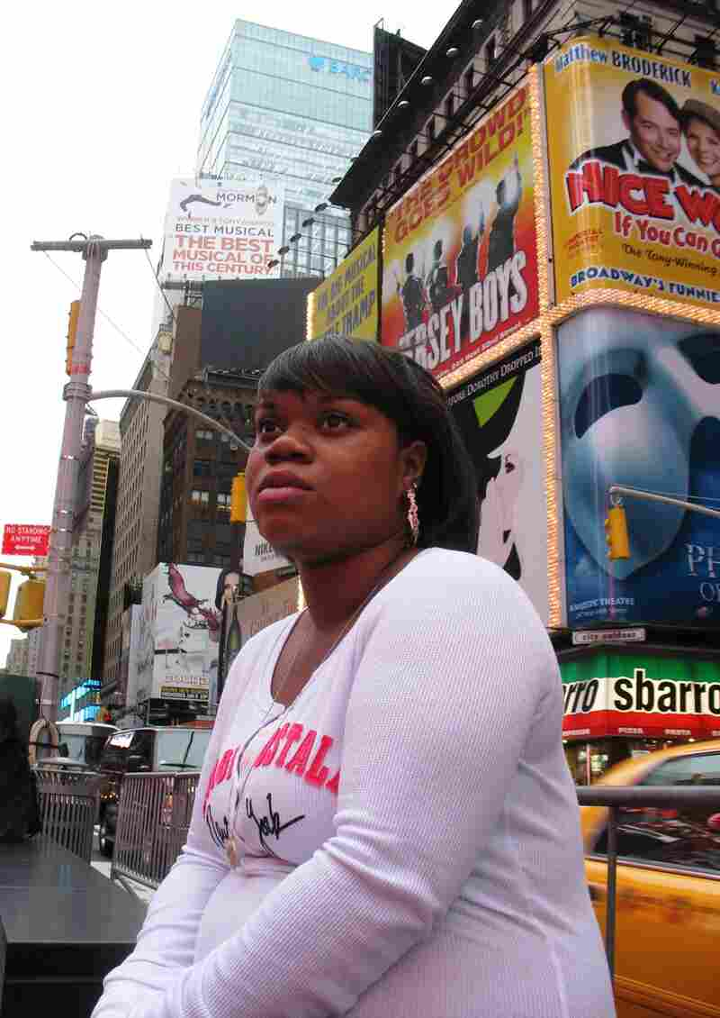 Natisha Laws near her hotel in the middle of Times Square. She and her family were placed at the DoubleTree in mid-November by FEMA. They lost their rental apartment during Superstorm Sandy and have been struggling to recover.