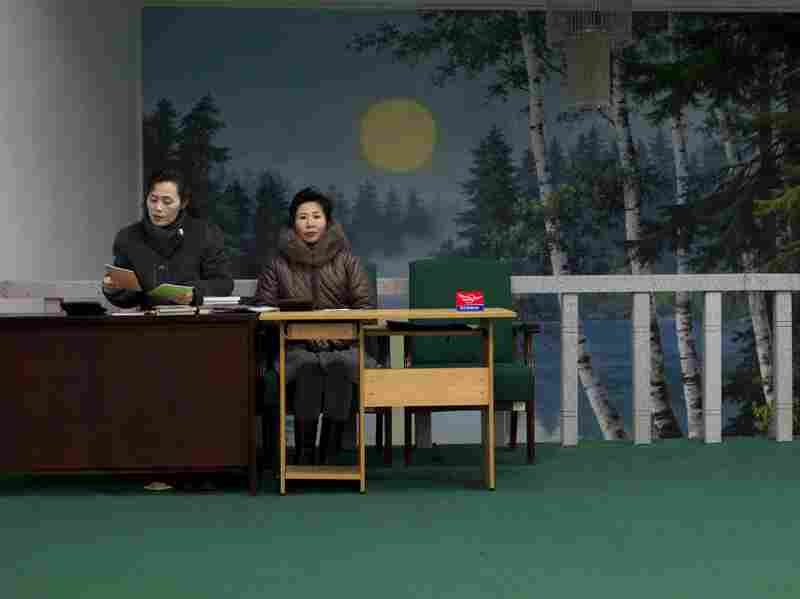 Women work at a bookstore in Pyongyang. With so many men unable to find work and support a family, more young women are willing to delay marriage.