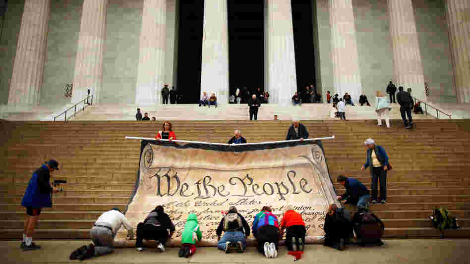 Opponents demonstrate against the Supreme Court's Citizens United ruling at the Lincoln Memorial in October. The decision changed campaigning, but it apparently didn't make ads more fact-based.