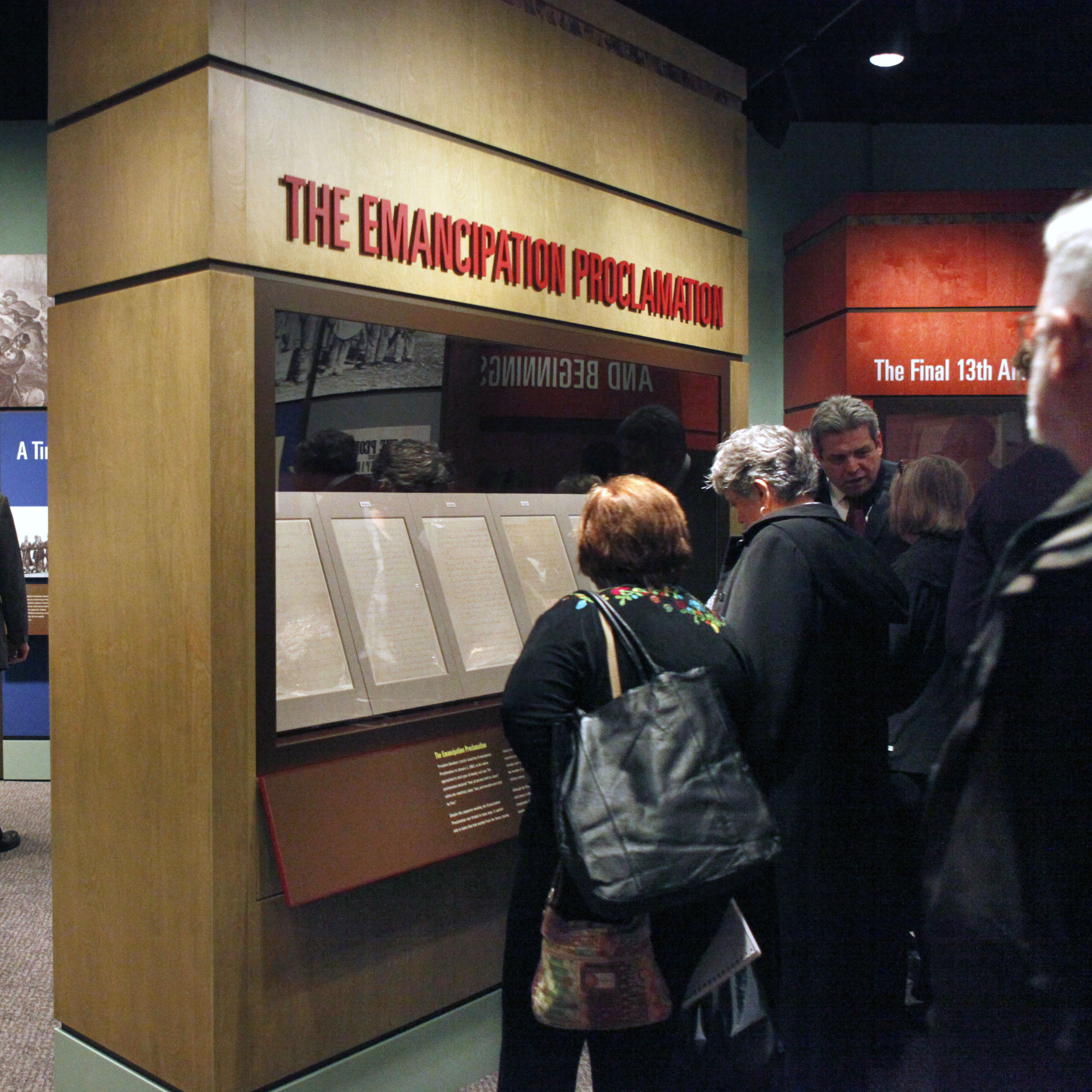 People look at a display of the emancipation proclamation at the National Archives in Washington, Thursday, Nov. 4, 2010.