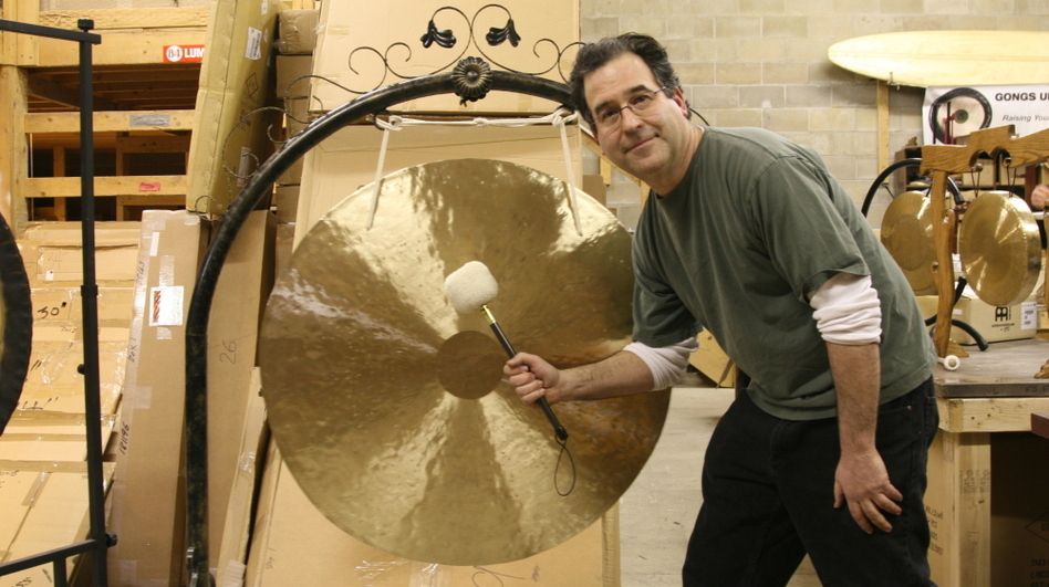 Comedy writer Andrew Borakove left California for Lincoln, Neb., to sell gongs. (Guy Raz)