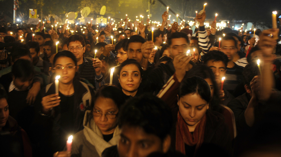 Protesters hold candles during a rally in New Delhi late Saturday following the death of a woman gang-raped on a bus. (AFP/Getty Images)
