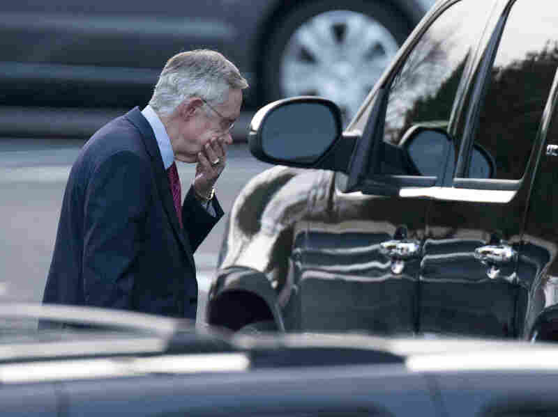 Senate Majority Leader Harry Reid of Nevada leaves the White House after a closed-door meeting with the president and congressional leaders.