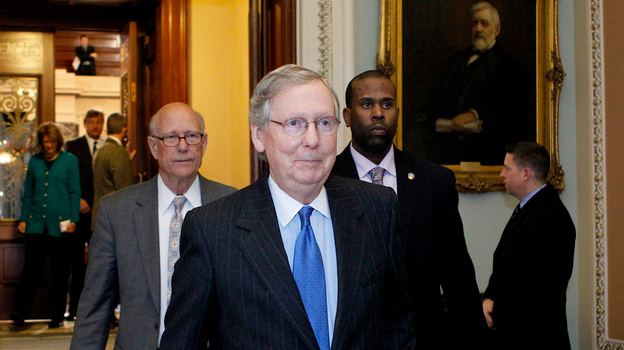 Senate Minority Leader Mitch McConnell, R-KY, leaves the Senate chamber to caucus in the Capitol on Sunday. (AFP/Getty Images)