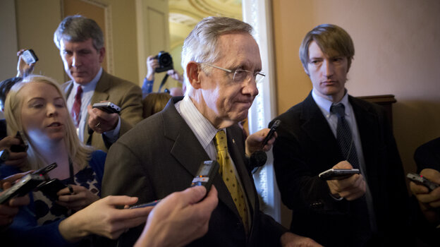 Senate Majority Leader Harry Reid, D-Nev., walks to a closed-door meeting with fellow Democrats at the Capitol on Sunday.