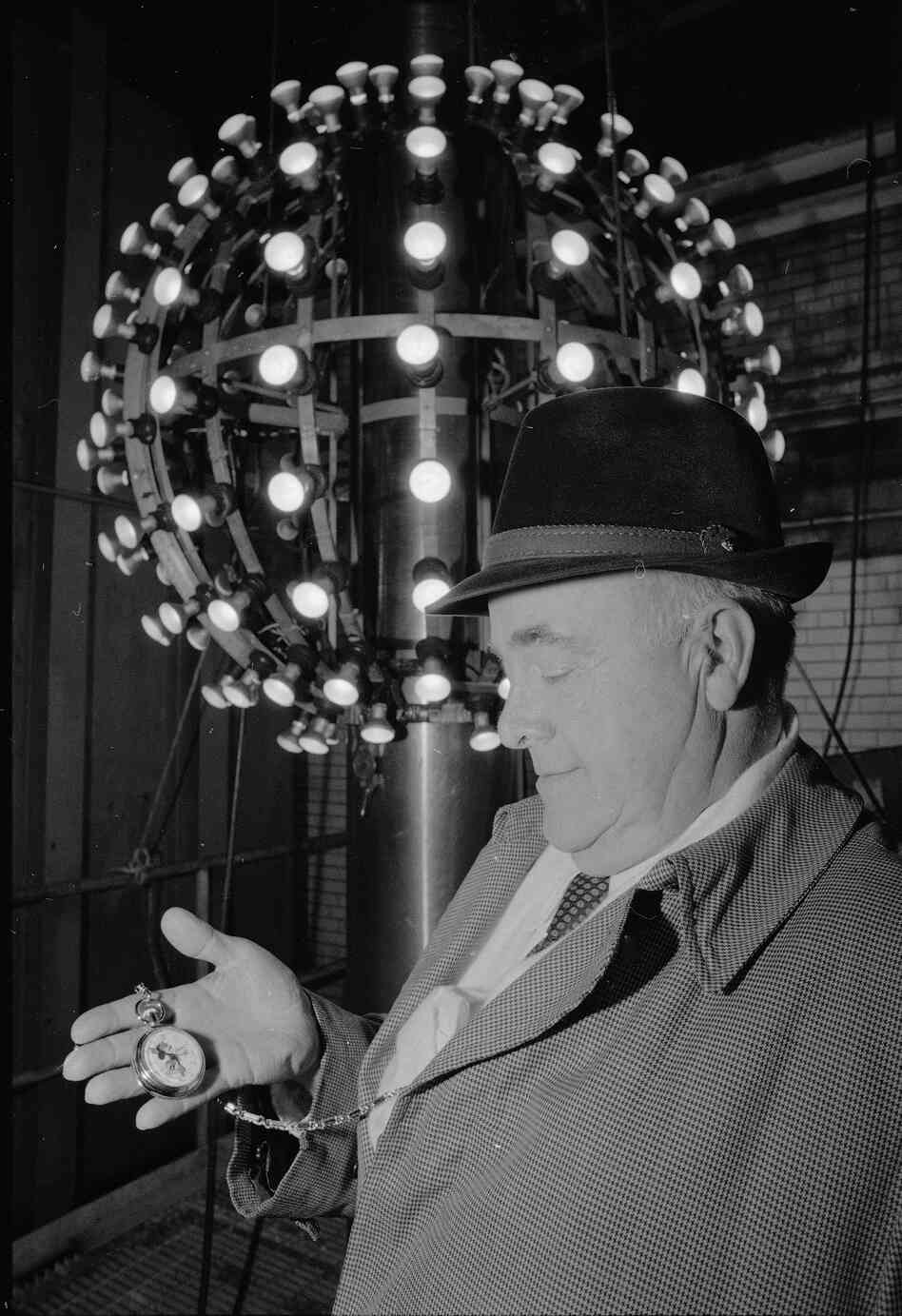 Russ Brown, superintendent of One Times Square, checks his watch a few hours before the ball is to be hoisted into position, Dec. 31, 1980. Brown officiated over the ball dropping for 16 years, and retired with the entry of 1981.