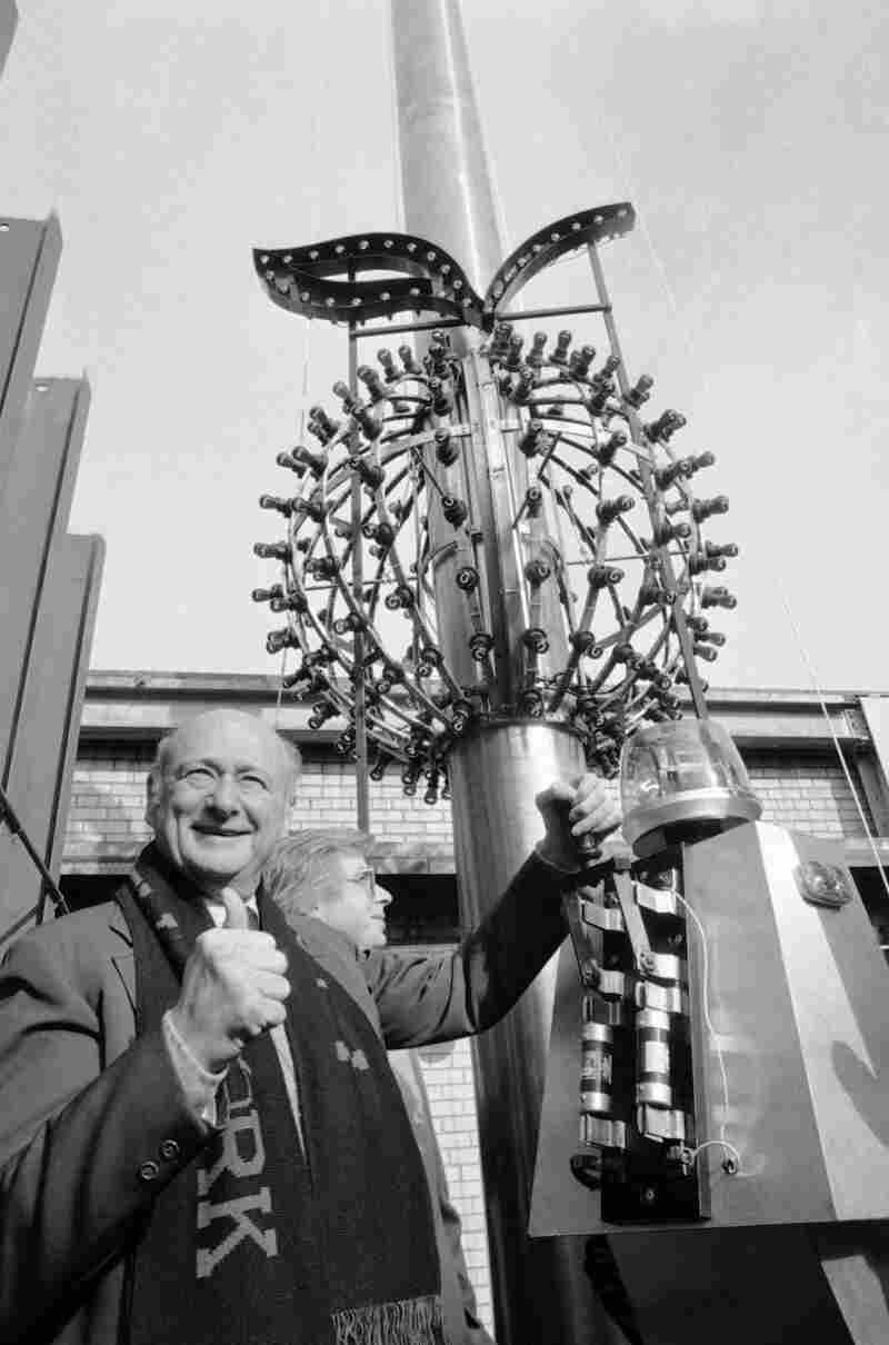"""For several years beginning in 1981, the ball was outfitted with red lights and a stem in keeping with the """"I Love New York"""" campaign. Then-New York City Mayor Ed Koch gives a thumbs up as he tests the lights in '81."""