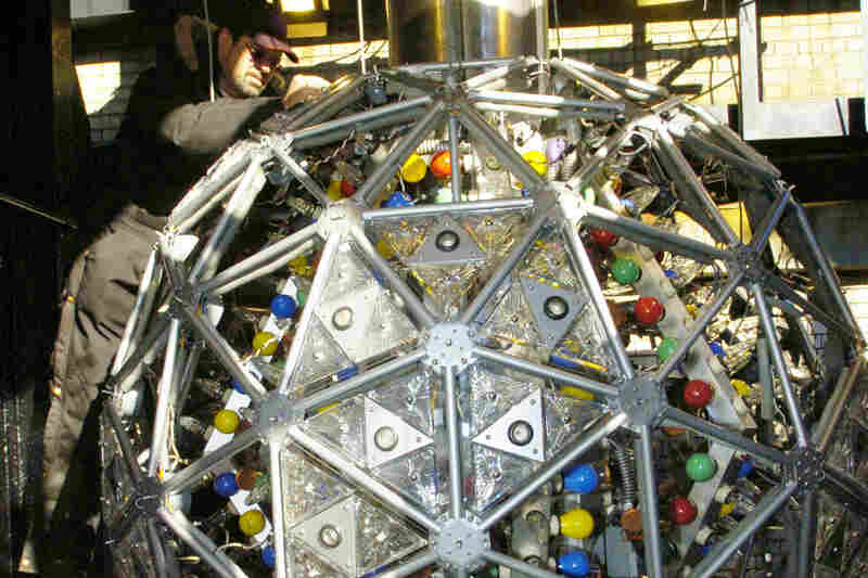 """A technician installs one of 72 new Waterford Crystal triangles, featuring the """"Hope for Fellowship"""" design, in 2005. A total of 504 crystal triangles with various designs from past years make up the exterior of the orb."""