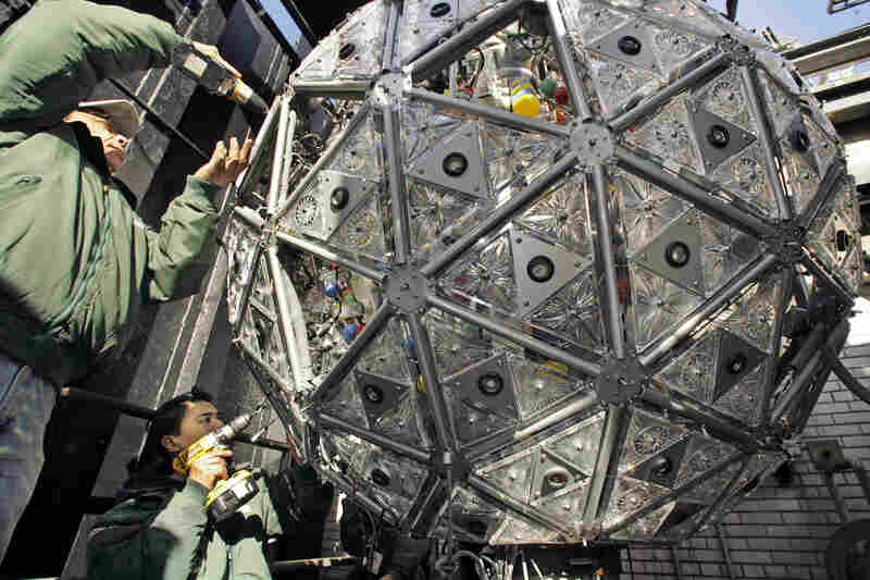 "Technicians install some of the 72 new Waterford crystal ""Hope for Peace"" triangles in 2006."